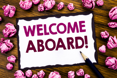 Photo for Hand writing text caption inspiration showing Welcome Aboard. Business concept for Greeting Join Member Written on sticky note paper, wooden background folded pink paper meaning thinking - Royalty Free Image