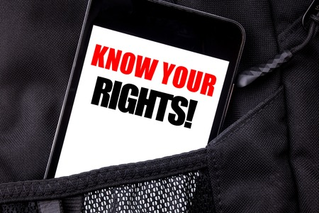 Photo for Handwritten text showing Know Your Rights. Business concept writing for Justice Education Written phone mobile phone, cellphone placed in  man front jeans pocket. - Royalty Free Image