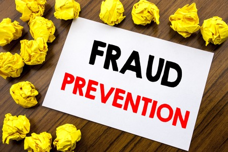 Photo pour Handwritten text showing word Fraud Prevention. Business concept writing Crime Protection Written on sticky note, wooden background with space office view with folded yellow paper - image libre de droit