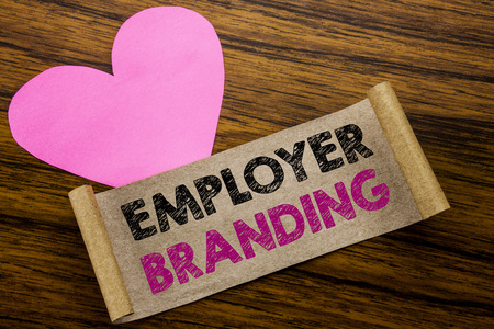 Photo pour Writing text showing Employer Branding. Business concept for Brand Building written on sticky note paper, wooden background. With pink heart meaning love adoration. - image libre de droit