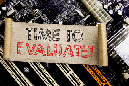 Photo for Writing text showing Time To Evaluate. Business concept for Assessment Evaluation Written on sticky, computer main board background. - Royalty Free Image
