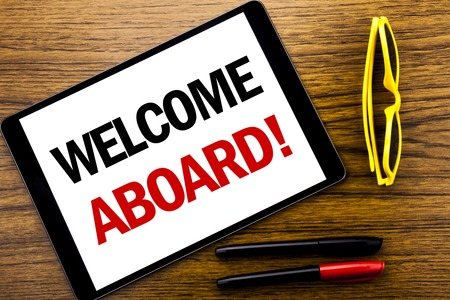 Photo for Writing text showing Welcome Aboard. Business concept for Greeting Join Member Written tablet laptop, wooden background with vacation yellow glasses and marker pen. - Royalty Free Image