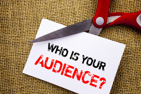 Foto de Handwriting text showing Who Is Your Audience Question. Conceptual photo Customer Target Service Client Research written Sticky Note Paper Cutting by Scissors the textured background - Imagen libre de derechos