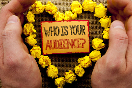 Foto de Conceptual writing showing Who Is Your Audience Question. Business photo showcasing Customer Target Service Client Research written Sticky Note Paper With Heart Holding Hand with Finger - Imagen libre de derechos