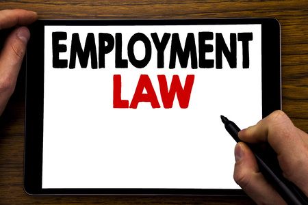 Photo pour Handwriting Announcement text showing Employment Law. Business concept for Employee Legal Justice Written tablet laptop, wooden background with businessman hand, finger writing on PC. - image libre de droit