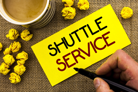 Foto per Text sign showing Shuttle Service. Conceptual photo Transportation Offer Vacational Travel Tourism Vehicle written Sticky Note Paper the jute background Cup and Paper Balls next to it. - Immagine Royalty Free