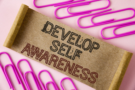 Photo pour Handwriting text writing Develop Self Awareness. Concept meaning What you think you become motivate and grow written Folded Cardboard paper piece plain background within Paper Pins. - image libre de droit
