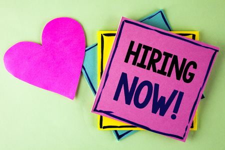 Photo for Writing note showing  Hiring Now Motivational Call. Business photo showcasing Workforce Wanted New Employees Recruitment written Pink Sticky Note Paper plain background Heart next to it. - Royalty Free Image