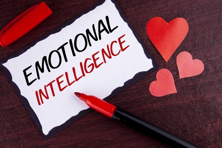 Foto de Conceptual hand writing showing Emotional Intelligence. Business photo text Capacity to control and be aware of personal emotions written Sticky Note Paper wooden background Marker and Hearts - Imagen libre de derechos
