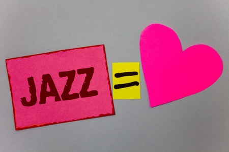 Foto de Text sign showing Jazz. Conceptual photo Type of music of black American origin Musical genre Strong rhythm Paper Heart equal sign gray background intentions love lovely messages - Imagen libre de derechos