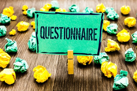 Photo pour Conceptual hand writing showing Questionnaire. Business photo showcasing Questions with a choice of answers Survey Statistical study Crumpled papers ideas mistakes paperclip clip objects wood - image libre de droit