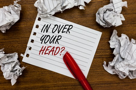 Photo for Conceptual hand writing showing In Over Your Head question. Business photo showcasing To be involved in a difficult situation problem Written white page touched red marker scattered paper lump - Royalty Free Image