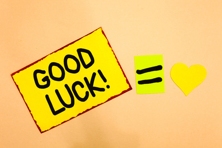 Foto de Conceptual hand writing showing Good Luck. Business photo text A positive fortune or a happy outcome that a person can have Yellow paper reminder equal sign heart sending romantic feelings - Imagen libre de derechos