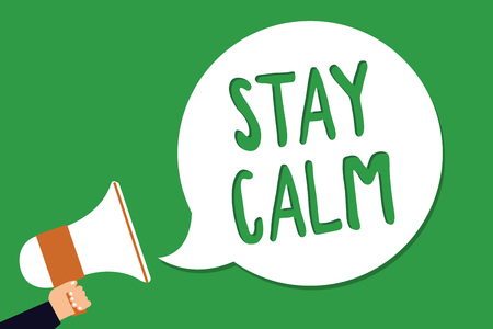 Foto de Conceptual hand writing showing Stay Calm. Business photo showcasing Maintain in a state of motion smoothly even under pressure Man holding megaphone loudspeaker screaming green background - Imagen libre de derechos