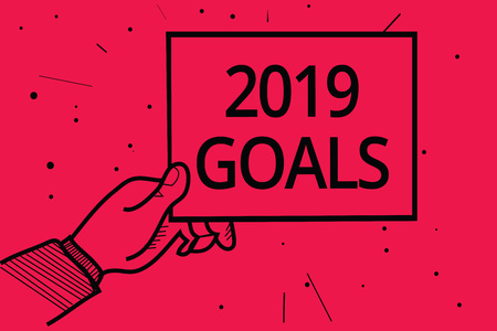 Photo for Conceptual hand writing showing 2019 Goals. Business photo text A plan to do for something new and better for the coming year Man holding paper communicating information dotted red background - Royalty Free Image