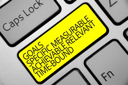 Photo pour Text sign showing Goals Specific Measurable Achievable Relevant Time Bound. Conceptual photo Strategy Mission Keyboard yellow key Intention create computer computing reflection document - image libre de droit