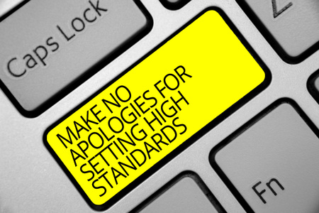 Photo for Text sign showing Make No Apologies For Setting High Standards. Conceptual photo Seeking quality productivity Keyboard yellow key Intention create computer computing reflection document - Royalty Free Image