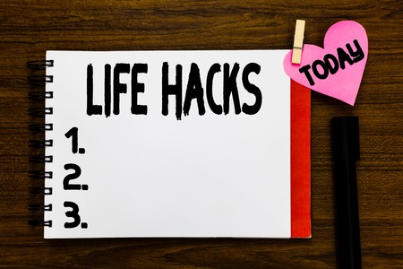 Foto de Conceptual hand writing showing Life Hacks. Business photo text Strategy technique to analysisage daily activities more efficiently Open notebook page markers holding paper heart wooden background - Imagen libre de derechos