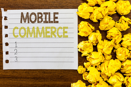 Photo pour Handwriting text Mobile Commerce. Concept meaning Using mobile phone to conduct commercial transactions online. - image libre de droit