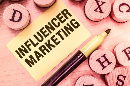 Photo pour Handwriting text writing Influencer Marketing. Concept meaning Endorser who Influence Potential Target Customers. - image libre de droit