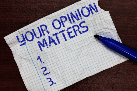 Foto de Writing note showing Your Opinion Matters. Business photo showcasing to Have your say Providing a Valuable Input to Improve Squared notebook paper Markers Communicating ideas Expressing feelings - Imagen libre de derechos