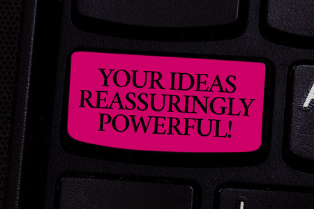Foto de Handwriting text writing Your Ideas Reassuringly Powerful. Concept meaning Power tranquillity in your thoughts Keyboard key Intention to create computer message pressing keypad idea - Imagen libre de derechos