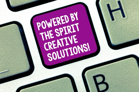Photo pour Handwriting text writing Powered By The Spirit Creative Solutions. Concept meaning Powerful new alternatives ideas Keyboard key Intention to create computer message, pressing keypad idea - image libre de droit