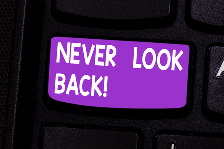Photo for Writing note showing Never Look Back. Business photo showcasing Do not have regrets for your actions be optimistic Keyboard key Intention to create computer message pressing keypad idea - Royalty Free Image