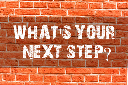 Foto de Writing note showing What S Your Next Stepquestion. Business concept for Analyse ask yourself before taking decisions Brick Wall art like Graffiti motivational call written on the wall - Imagen libre de derechos