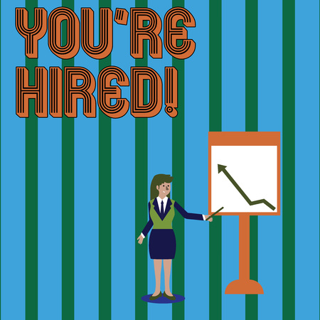 Foto de Writing note showing You Re Hired. Business concept for Used by huanalysis resources indicate employee that he is got job Woman Holding Stick Pointing to Chart of Arrow on Whiteboard - Imagen libre de derechos