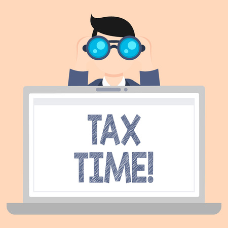 Foto de Writing note showing Tax Time. Business concept for when individual taxpayers prepare their financial statements Man Holding and Looking into Binocular Behind Laptop Screen - Imagen libre de derechos