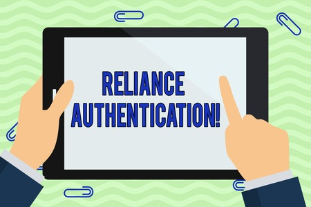Foto de Writing note showing Reliance Authentication. Business concept for part of trust based identity attribution process Hand Holding Pointing Touching Color Tablet White Screen - Imagen libre de derechos