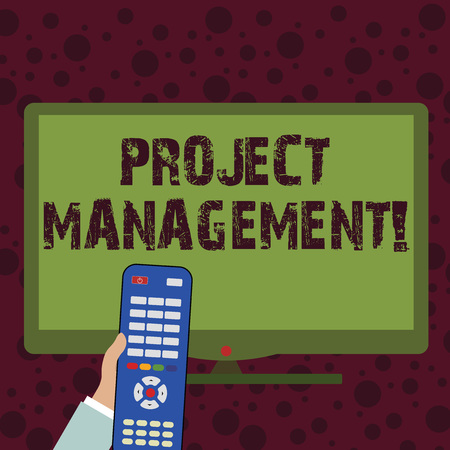 Foto de Conceptual hand writing showing Project Management. Concept meaning practice of initiating planning controlling work team Hand Holding Remote Control infront of Wide Color PC Screen - Imagen libre de derechos
