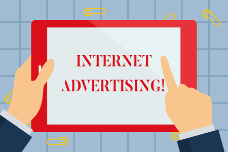 Foto de Text sign showing Internet Advertising. Business photo text uses the Internet to deliver promotional marketing Hand Holding Pointing Touching Blank Rectangular Color Tablet White Screen - Imagen libre de derechos