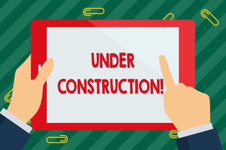 Photo for Word writing text Under Construction. Business photo showcasing project that is unfinished but actively being worked on Businessman Hand Holding, Pointing and Touching Colorful Tablet Blank Screen - Royalty Free Image