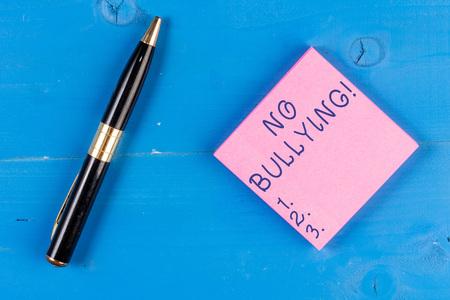 Foto de Handwriting text writing No Bullying. Conceptual photo stop aggressive behavior among children power imbalance - Imagen libre de derechos