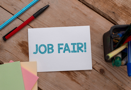 Photo for Conceptual hand writing showing Job Fair. Concept meaning event in which employers recruiters give information to employees Note papers and stationary placed sideways softhued backdrop - Royalty Free Image