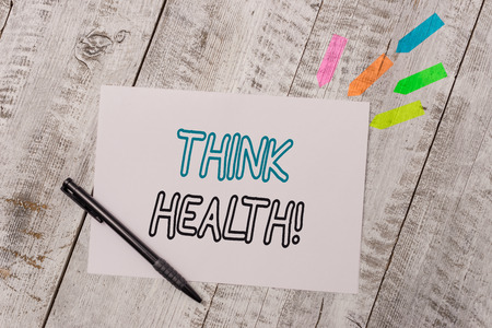 Photo pour Handwriting text Think Health. Conceptual photo state of complete physical mental and social well being Plain note paper and line arrow stickers with pen above the wooden table - image libre de droit