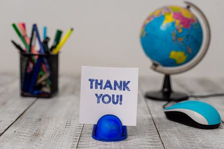 Photo for Conceptual hand writing showing Thank You. Concept meaning polite expression used when acknowledging gift service compliment Stationary and computer mouse with globe on the wooden desk - Royalty Free Image