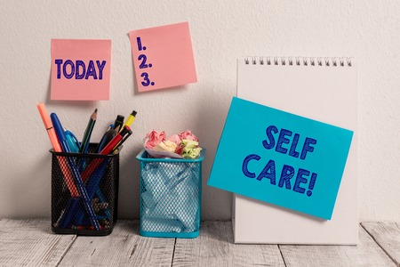 Photo pour Writing note showing Self Care. Business concept for practice of taking action preserve or improve ones own health Sticky Notes Card on Wall Spiral Notebook 2 Mesh Pencil Pots Work Desk - image libre de droit