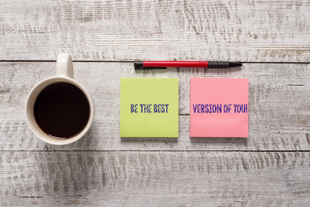 Foto de Text sign showing Be The Best Version Of You. Business photo text going to move away from where are start improving Stationary placed next to a cup of black coffee above the wooden table - Imagen libre de derechos