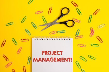 Foto de Word writing text Project Management. Business photo showcasing Application Process Skills to Achieve Objectives and Goal Blank no color spiral notepad scissors clips colored background design - Imagen libre de derechos