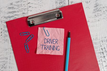 Photo pour Writing note showing Driver Training. Business concept for prepares a new driver to obtain a driver s is license Colored clipboard crushed sticky note clip marker old wooden background - image libre de droit