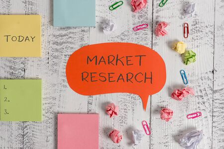 Photo pour Word writing text Market Research. Business photo showcasing The acttion of gathering information about consumers Blank speech bubble paper balls clips sticky notes old wooden background - image libre de droit