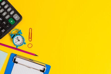 Foto de Clock clips crushed note calculator pencil clipboard band color background - Imagen libre de derechos