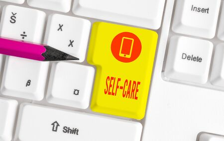 Photo pour Word writing text Self Care. Business photo showcasing practice of taking action preserve or improve ones own health White pc keyboard with empty note paper above white background key copy space - image libre de droit