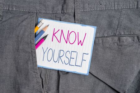 Photo for Handwriting text Know Yourself. Conceptual photo Find You Understanding Strength and Weaknesses Identity Writing equipment and white note paper inside pocket of man work trousers - Royalty Free Image