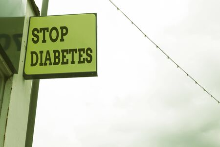 Foto per Word writing text Stop Diabetes. Business photo showcasing Blood Sugar Level is higher than normal Inject Insulin Green ad board on the street with copy space for advertisement - Immagine Royalty Free