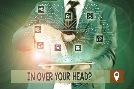 Photo for Handwriting text writing In Over Your Head Question. Conceptual photo To be involved in a difficult situation problem Male human wear formal work suit presenting presentation using smart device - Royalty Free Image