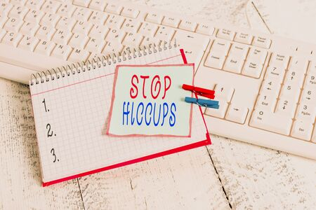 Photo for Conceptual hand writing showing Stop Hiccups. Concept meaning get rid of the involuntary spasm of the diaphragm muscles notebook reminder clothespin with pinned sheet light wooden - Royalty Free Image